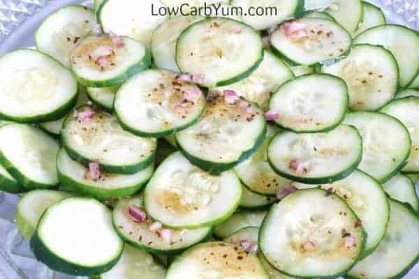 Cucumber salad typically has sugar added to offset the vinegar. This low carb apple cider vinegar cucumber salad recipe uses stevia as the sweetener. | LowCarbYum.com