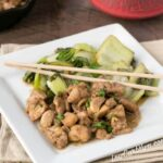 Low Carb Filipino Chicken Adobo with cooked celery and chopsticks