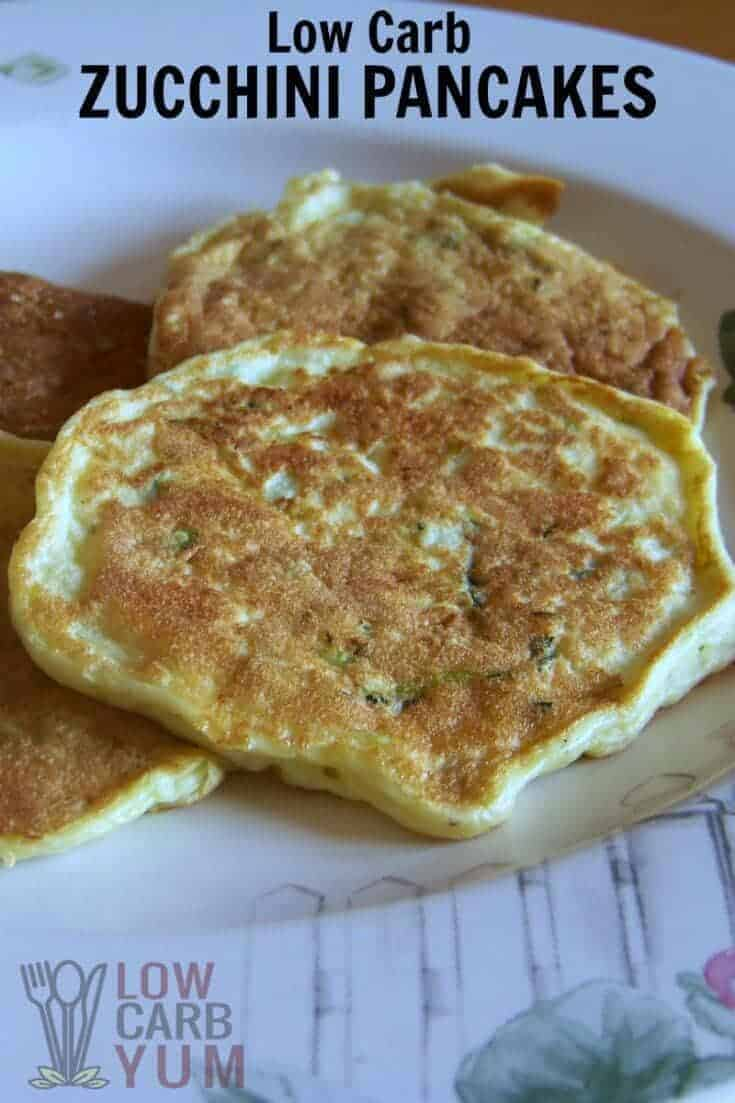 These low carb zucchini pancakes are one way to use up some extra summer crops. Can be enjoyed at breakfast or as a side to dinner. | LowCarbYum.com