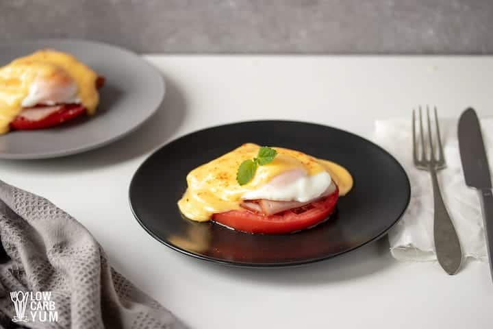 serving poached eggs with hollandaise sauce