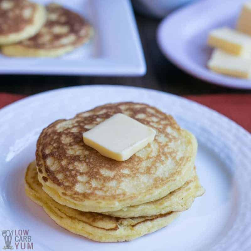 Coconut Flour Pancakes on plate with slice of butter on pancake