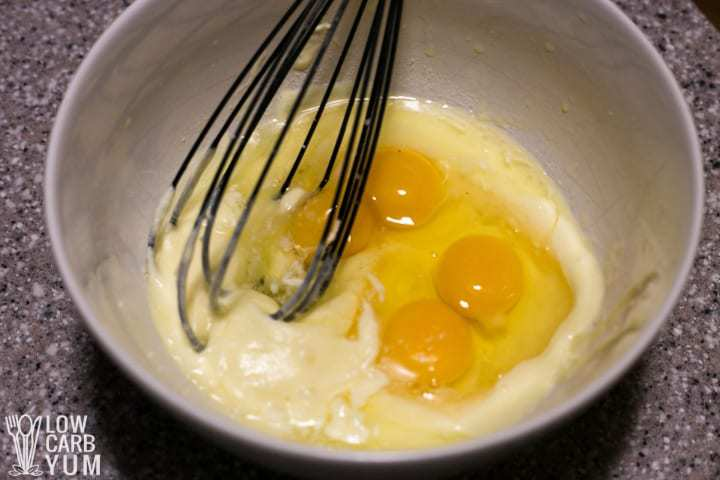 Whisking eggs into cream and butter mixture