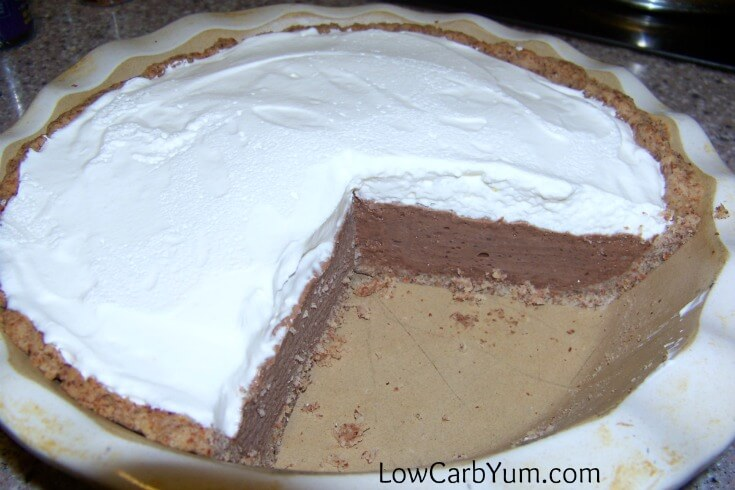 A delicious low carb chocolate cream pie sweetened with natural sweeteners. The crust is made from ground almonds and the top is a stabilized whipped cream.