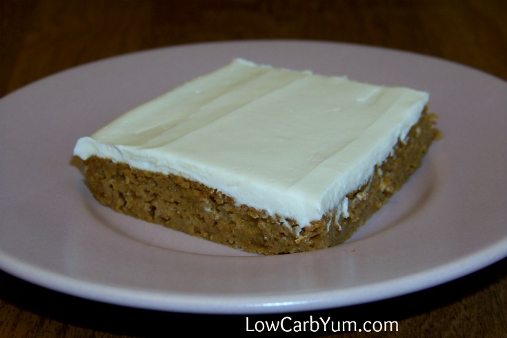 Lovely pumpkin spice snack cake bars topped with sweet cream frosting. These low carb frosted pumpkin bars are a delicious snack that all will enjoy.