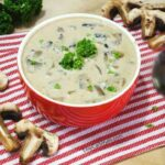 low carb gluten free cream of mushroom soup with mushrooms and spoon