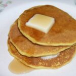 Pancakes with slice of butter on plate