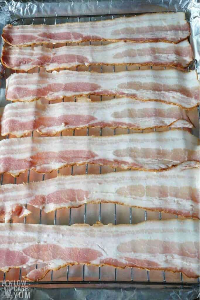 raw bacon on a baking rack