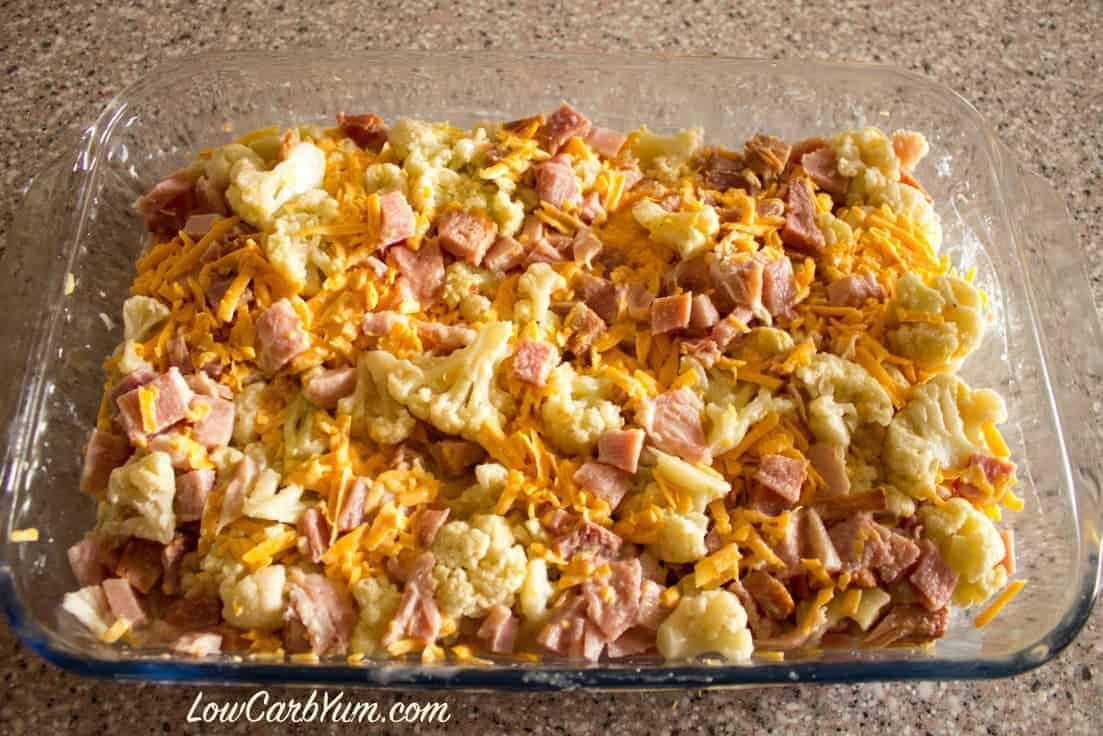preparing cheese cauliflower ham in casserole