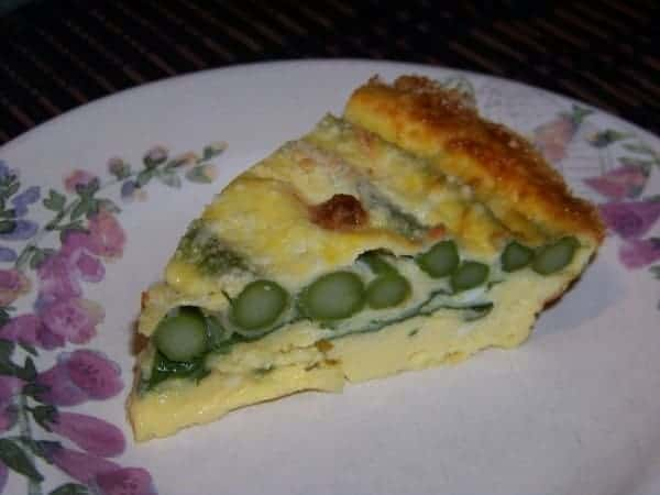 Crustless asparagus quiche with some baby spinach leaves that's ...