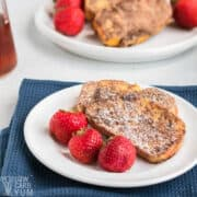 low-carb keto french toast slices with powdered sweetener on white plate
