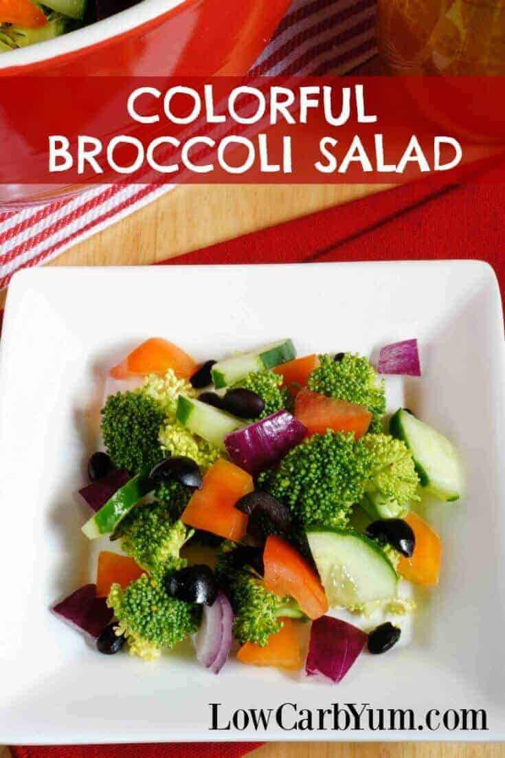 A colorful low carb cucumber broccoli salad made with a variety of different colored vegetables. It's a pretty dish to take along to any potluck.
