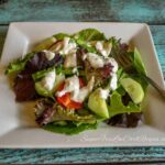 creamy blue cheese dressing topped salad