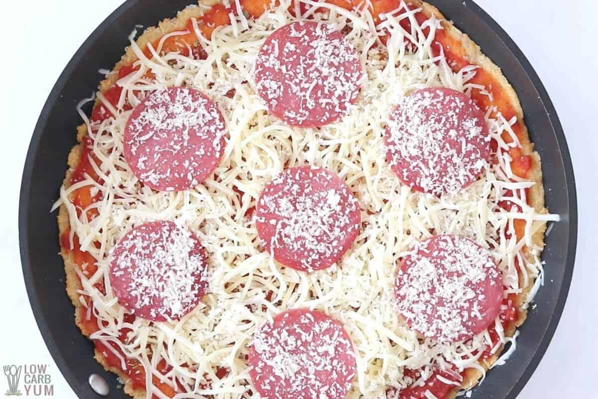 unbaked keto deep dish pizza in skillet