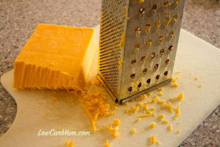 Grating cheese with grater