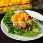 Layered taco salad dip with ground beef and cream cheese