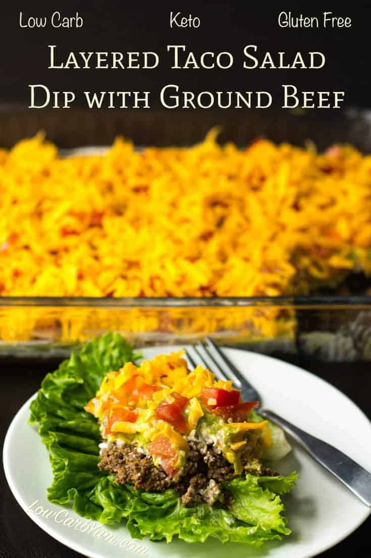 This low carb layered taco salad dip with ground beef is made with refried soy beans. Perfect served as a salad topping or for dipping keto tortilla chips.