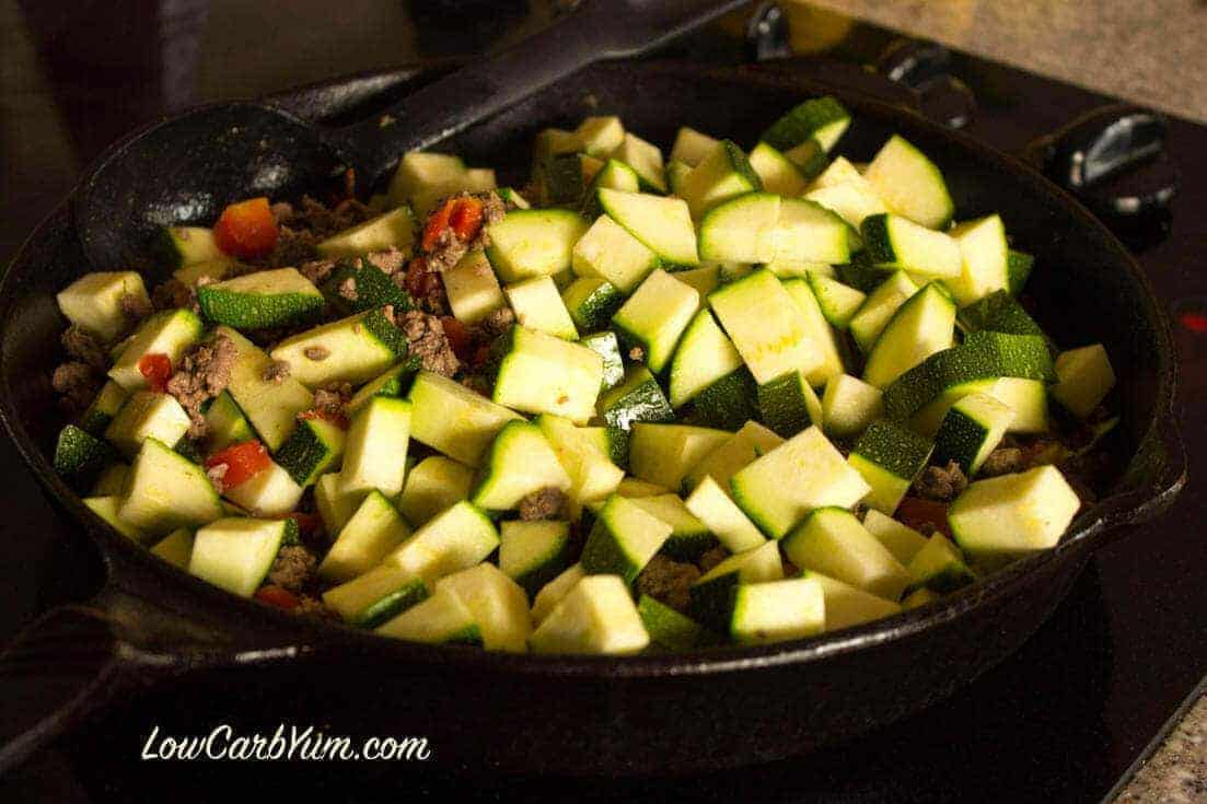 Adding Mexican zucchini to beef in skillet