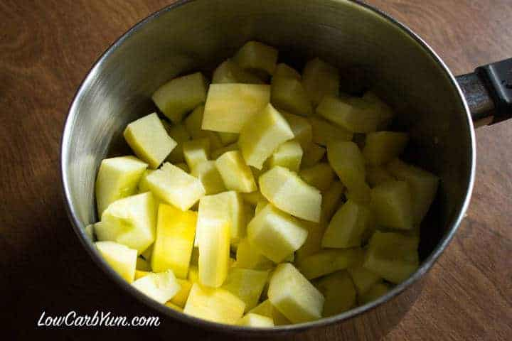 Peeled and cut yellow squash in pan