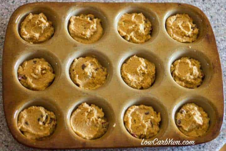 Coconut flour cranberry pumpkin muffin batter in pan