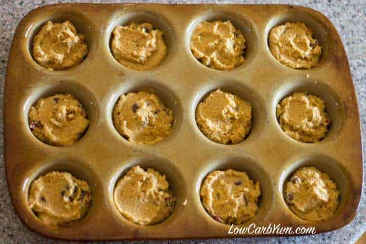 Coconut flour cranberry pumpkin muffin batter in pan