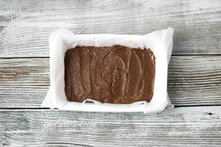 dairy-free chocolate peanut butter fudge spread in lined pan