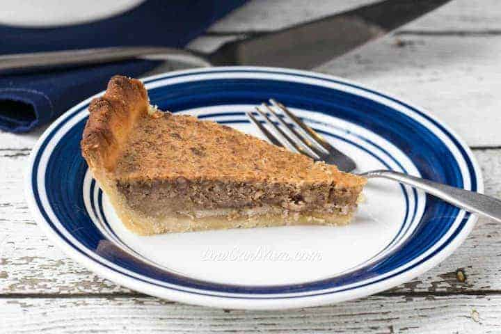 Slice of low carb pecan pie on plate
