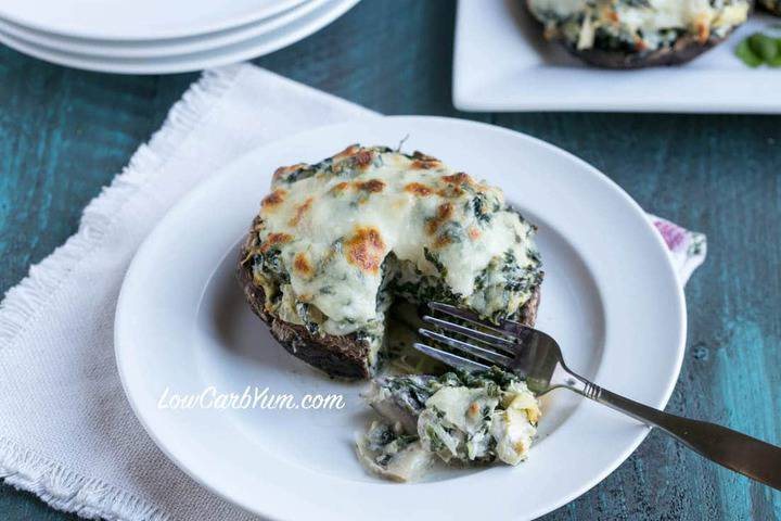 fork cut into spinach artichoke mushroom