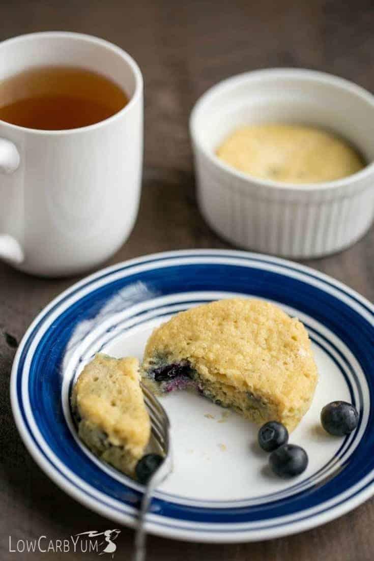 blueberry mug cake on a white and blue plate