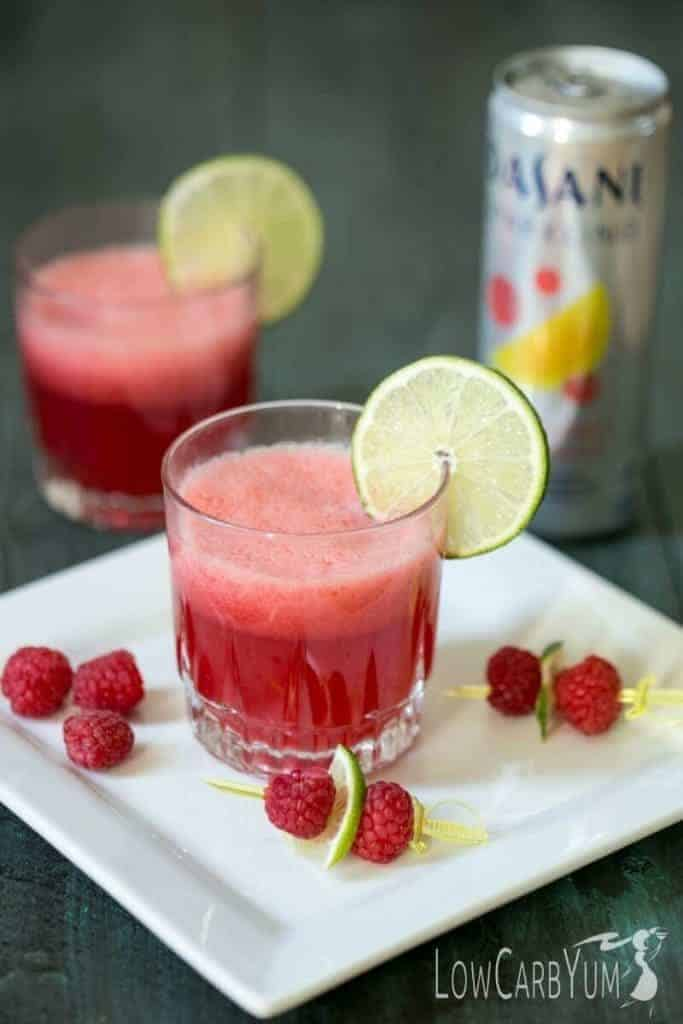 Make any day special with this low carb sparkling raspberry limeade mocktail. It's a low calorie sweet fruity drink to help you make every moment sparkle. | LowCarbYum.com