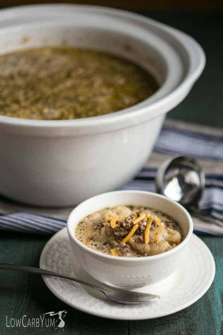 It's great to come home to a warm bowl of low carb crock pot cheeseburger soup. Just prep the ingredients in the slow cooker before leaving. | LowCarbYum.com