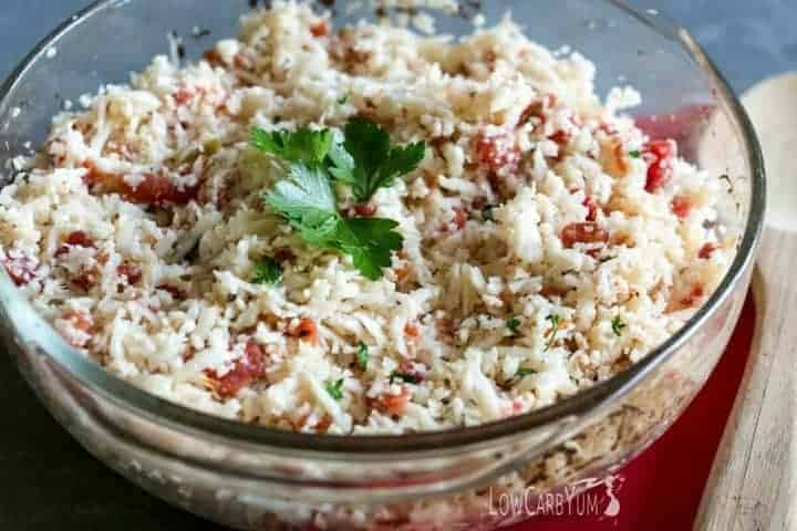 An easy low carb Mexican cauliflower rice that only takes a couple minutes to prepare. And, this simple dish can be made with only 4 common ingredients! LowCarbYum.com