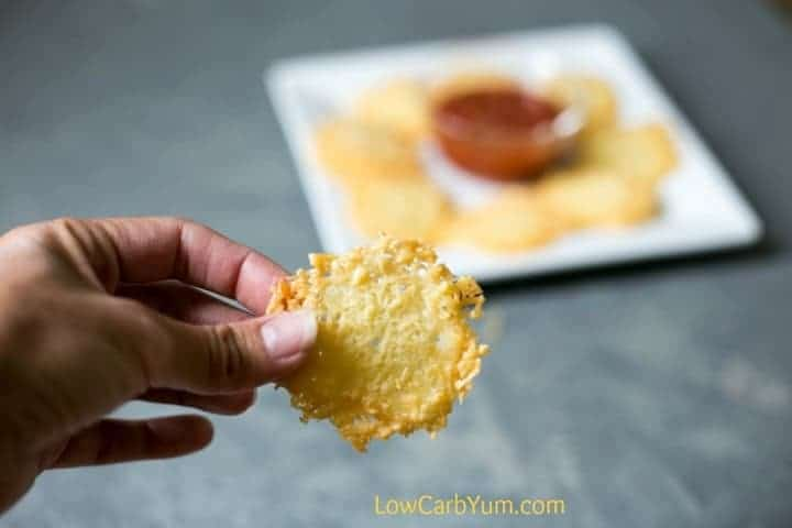 Want a crunchy low carb snack that takes only a few minutes to make? You can bake up a batch of easy Parmesan crisps in less than ten minutes! | LowCarbYum.com