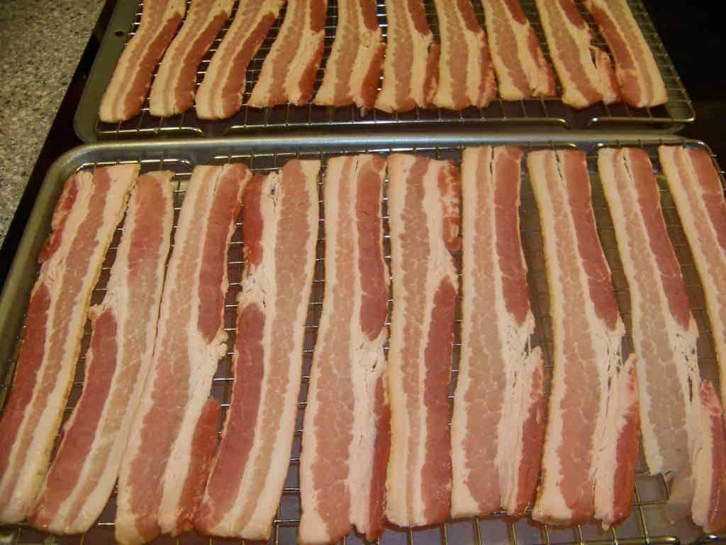 Bacon on racks before baking