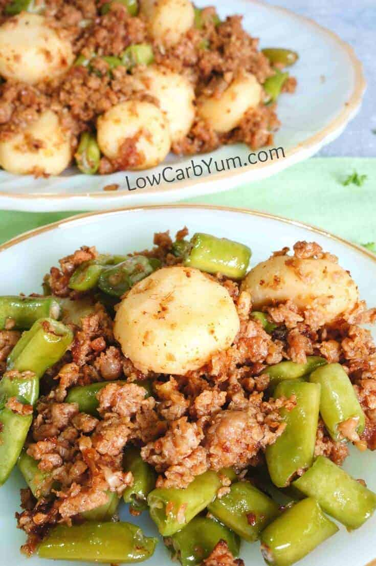 green beans and ground beef on plates