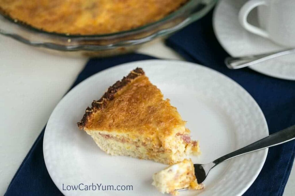 A tasty low carb bacon cheddar quiche that doesn't use any special flour for the crust. Instead, it uses a gluten free cauliflower crust! | LowCarbYum.com