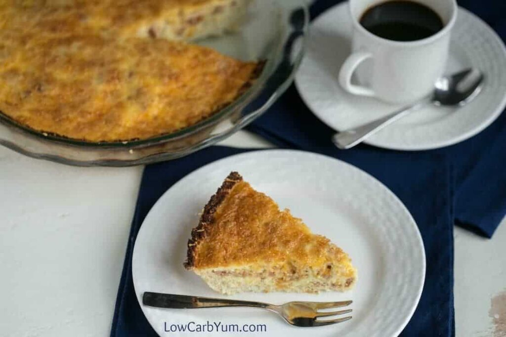 A tasty low carb bacon cheddar quiche that doesn't use any special flour for the crust. Instead, it uses a gluten free cauliflower crust!   LowCarbYum.com