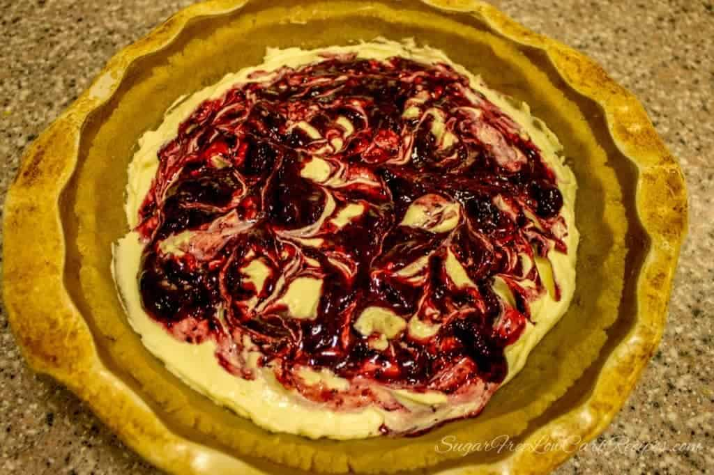 low carb blueberry swirl cheesecake before baking