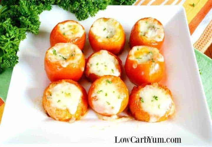 Cheese stuffed tomatoes with ground meat on plate
