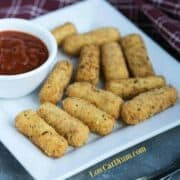 low carb gluten free mozzarella sticks with sauce on plate