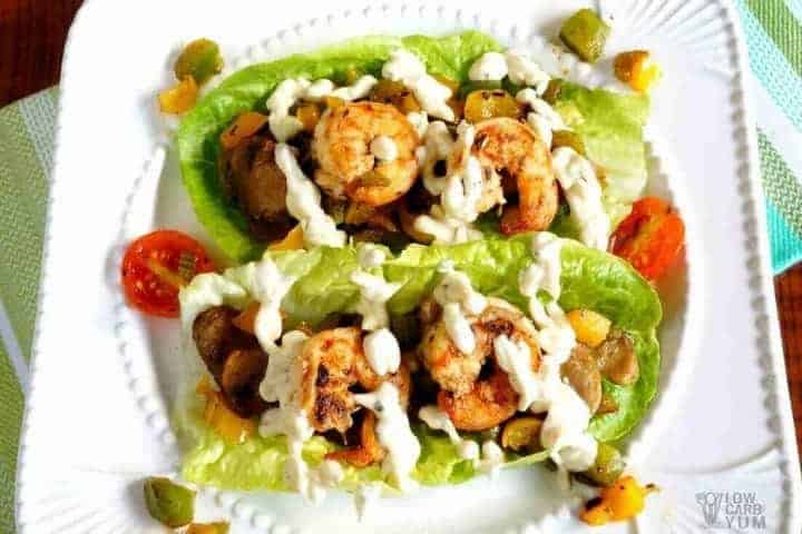 Cajun cream sauce over shrimp lettuce wraps featured