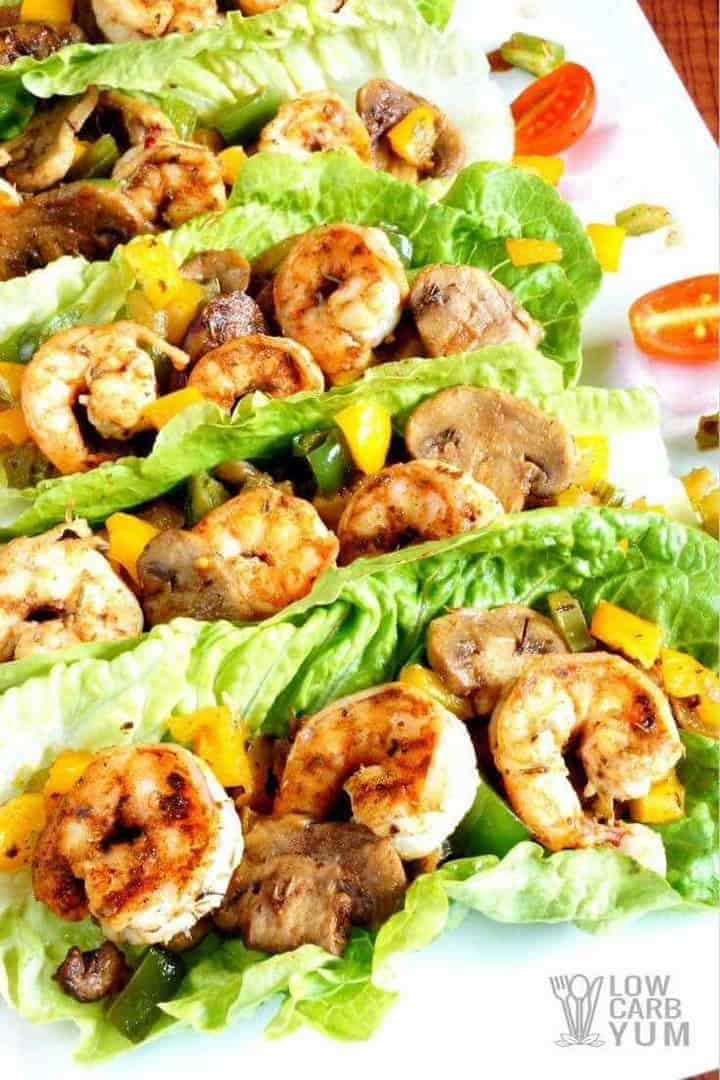 Cajun cream sauce over shrimp lettuce wraps serving
