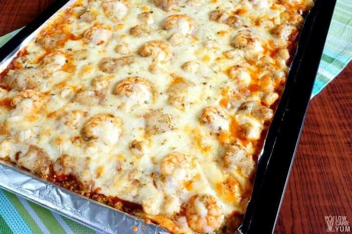Cauliflower sheet pan pizza with fish, shrimp, and scallops