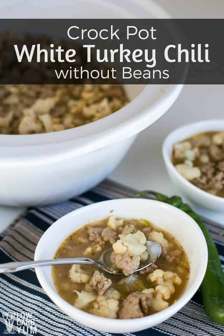 A healthy recipe for crock pot white turkey chili without beans that's low carb and full of flavor. It's dairy-free, but cheese or sour cream could be added on top if desired. #healthyrecipe #easyrecipe #crockpot | LowCarbYum.com