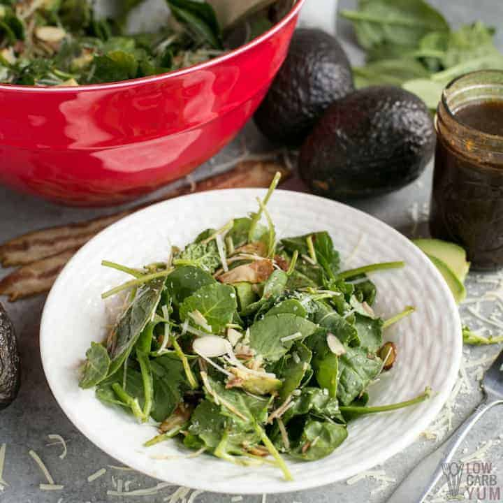 Plate of baby kale avocado salad with parmesan cheese