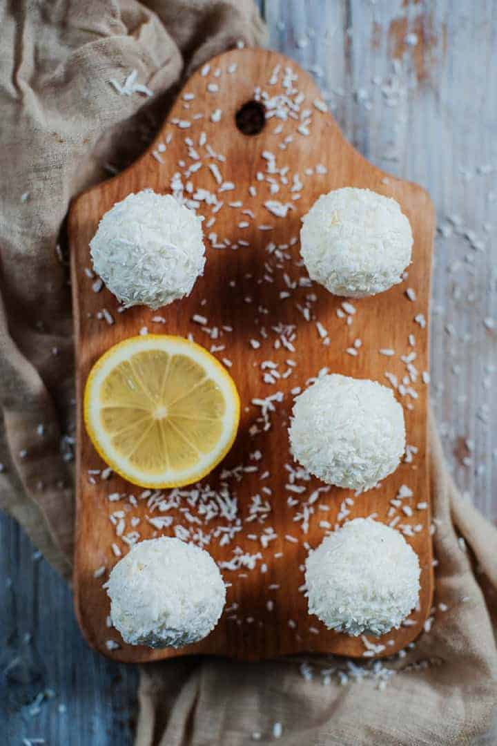Low carb lemon coconut cream cheese balls on cutting board