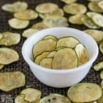 Oven baked zucchini chips in a small bowl