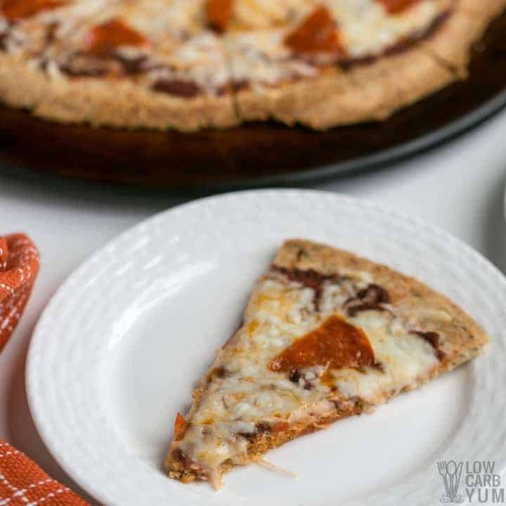 Slice of almond flour pizza crust keto pizza