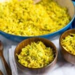Serving turmeric cabbage rice in bowls
