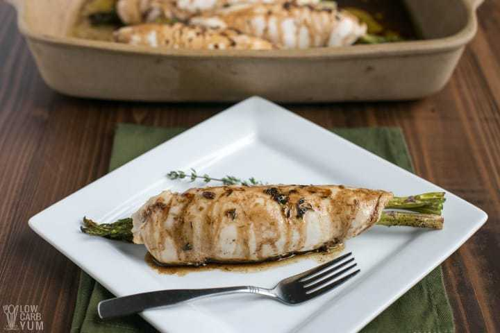 Uncut asparagus stuffed chicken on plate