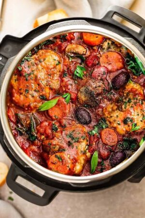 vertical close up image of chicken cacciatore in instant pot